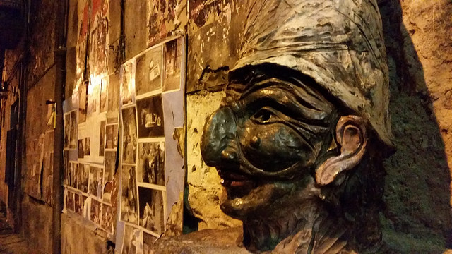 A mask of Pulcinella on a wall in Naples